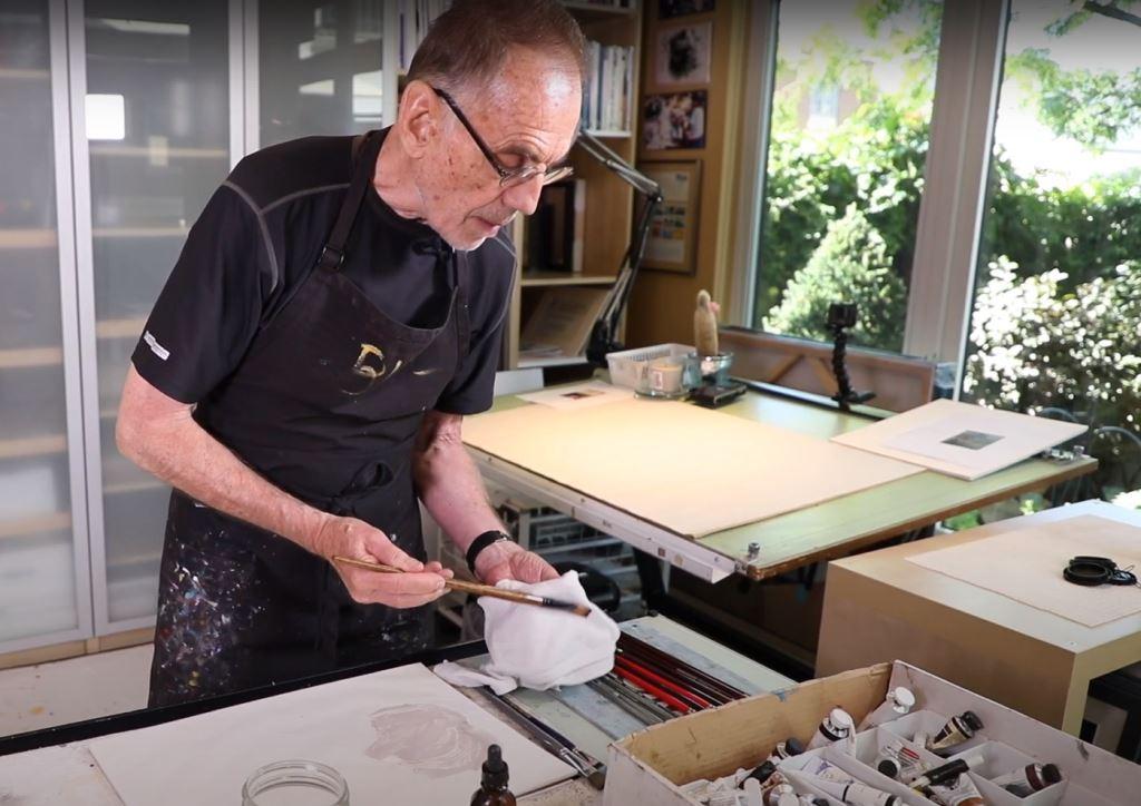 Bill Schwarz working on his painting in studio